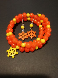 Oranssi kieppirannekoru ja korvakorut