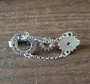 Silver-colored steampunk tie clip with chain