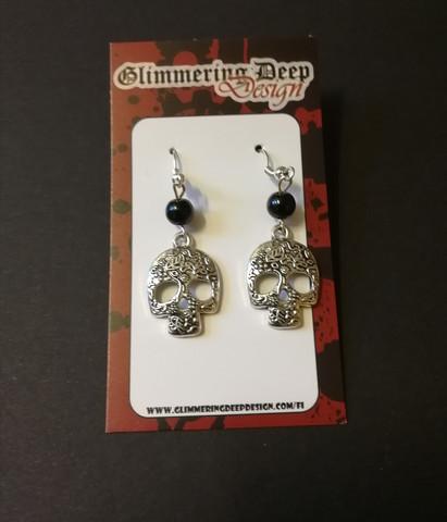 Patterned skull earrings