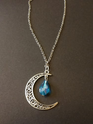 Crescent moon with turquoise droplet
