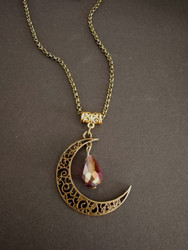 Bronze crescent moon with violet rainbow droplet
