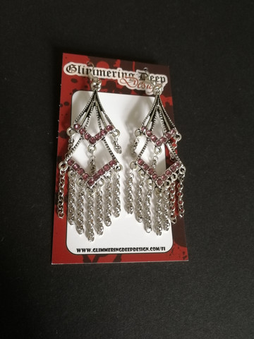 Hanging earrings with chains