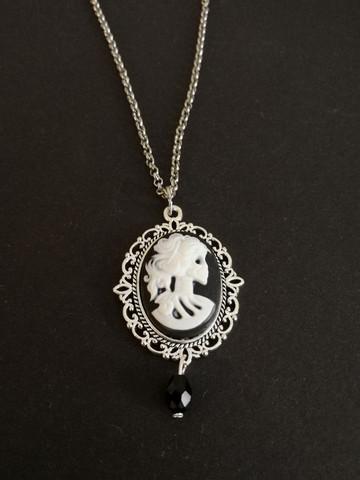 Black and white skeleton necklace