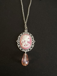 Pink skeletal woman necklace