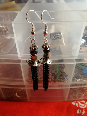 Silver flower earrings with black chains