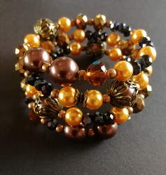 Bronze colored and gold colored bracelet
