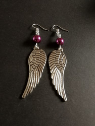 Silver colored wing earrings violet bead