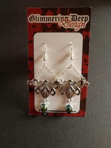 Chandelier earrings with green droplets