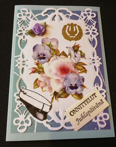 Ylioppilaalle kortti lakki ja kukkakimppu