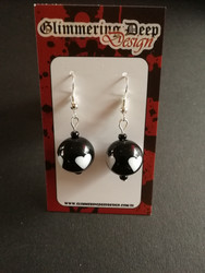 Black ball bead earrings with white heart
