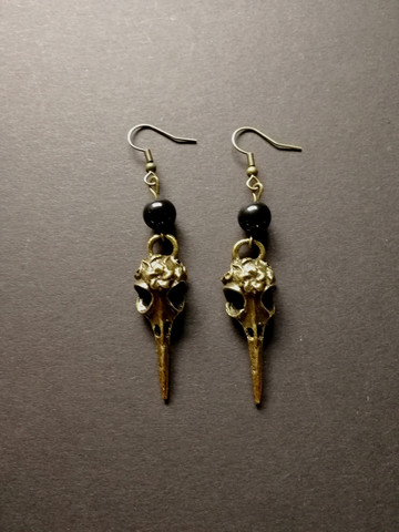 Bird skull earrings with black beads