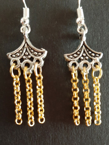 Silver colored and gold colored hanging earrings