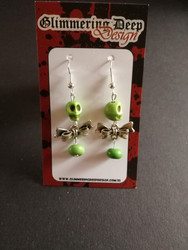 Green bow skull earrings