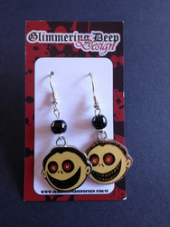 Face earrings with black beads