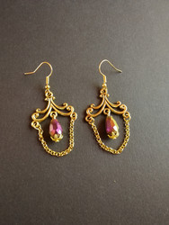 Hanging gold coloring earrings with purple drop