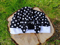 Black bow hat with white dots