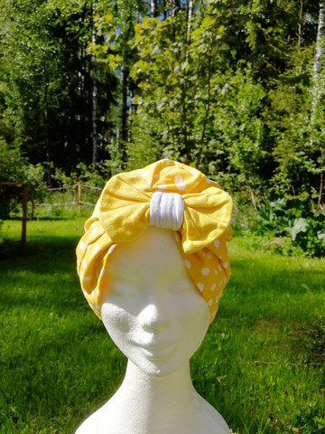 Yellow hat with bow and white dots and yellow bow