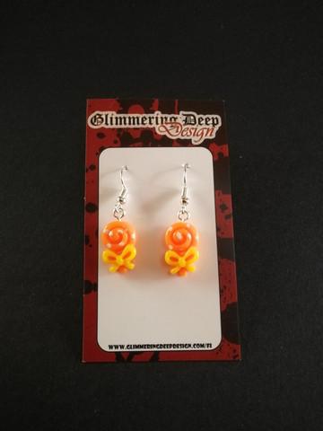 Orange lollipop earrings with dots