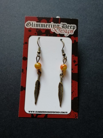 Bronze colored feather earrings with patterned beads