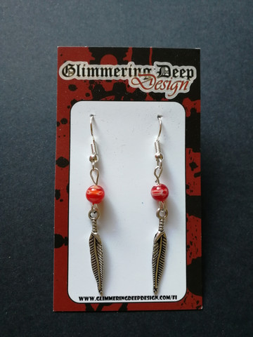 Silver colored feather earrings with red beads