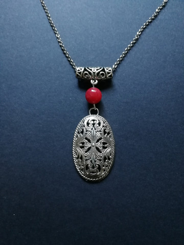 Medieval necklace with a red stone