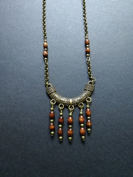 Bronze colored necklace with wood beads