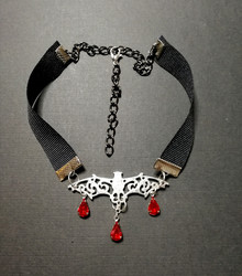 Bat necklace with red droplets