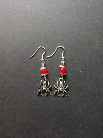 Spider earrings with red beads