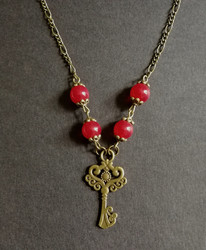 Key necklace with red beads