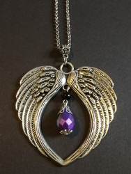 Silver colour wings necklace with violet drop