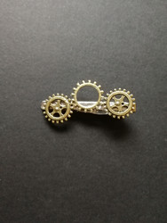 Steampunk tie clip with gold-colored gears