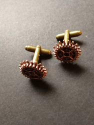 copper-colored gear cuff-links