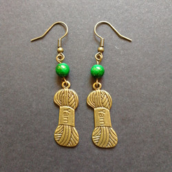 Yarn earrings with green shell beads