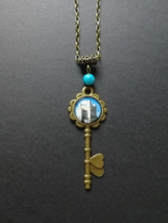 Key necklace with castle and blue bead