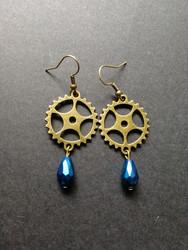 Gear earrings with blue drop
