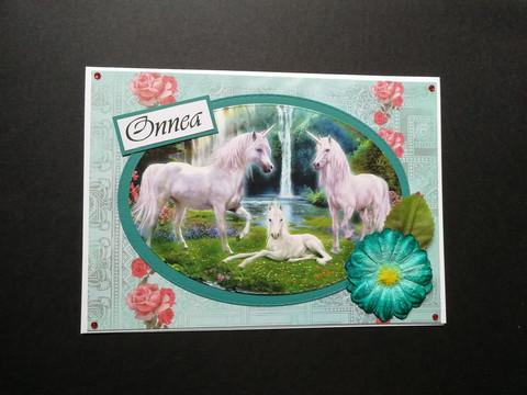 Card with three unicorns
