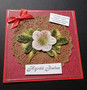 Christmas card flower on a red base