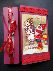 Red candle card with an elf and a goat