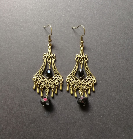 Hanging drop earrings with black beads