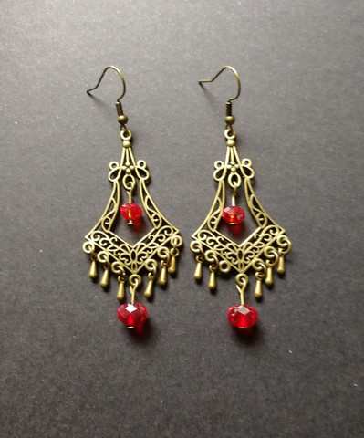 Hanging drop earrings with red beads