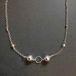 Silver colored bead necklace