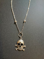Small skull and cross bones necklace