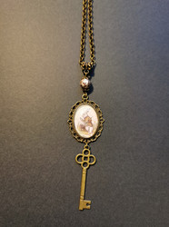 White rabbit and key necklace