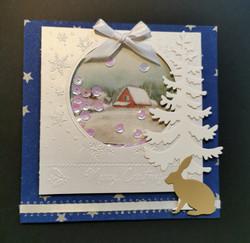 Ravistettava joulukortti mökkimaisema