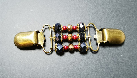 Red and bronze colored sweater clip