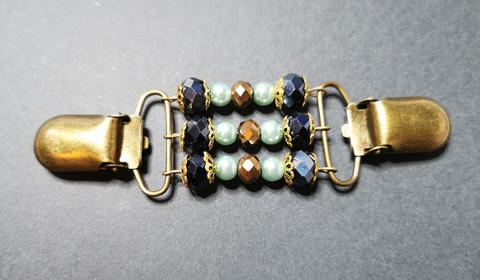 Black, green and bronze sweater clip