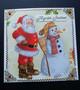 Joulupukki ja lumiukko kortti