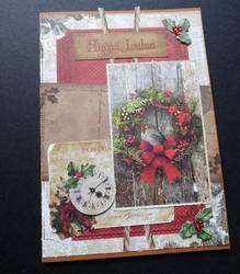 Christmas card with bird in wreath