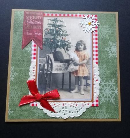 Joulukortti tyttö ja hiutaleet