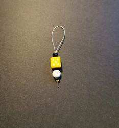 Yellow dice place marker